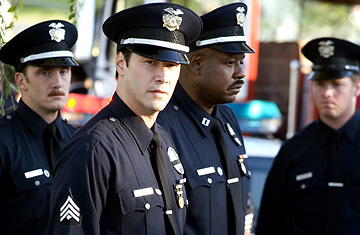 Keanu Reeves wearing an authentic LAPD uniform in Street Kings