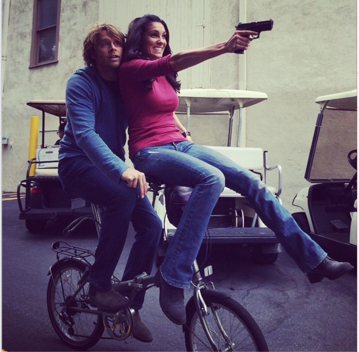 eric christian olsen amp daniela ruah ride a bicycle built